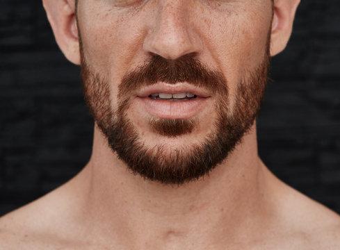 Nude man closeup beard