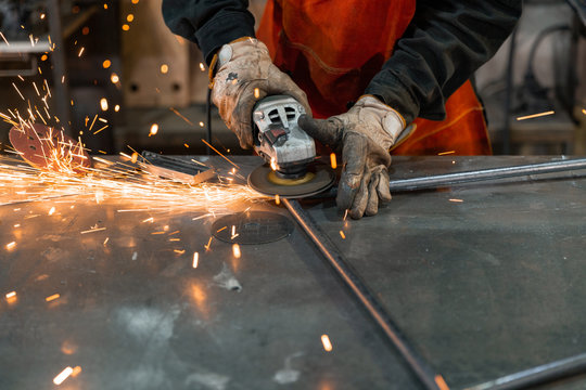 Crop welder grinding metal frame