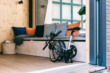 Folding Bike at Tiny House Entrance