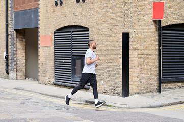 Urban male sprinter.