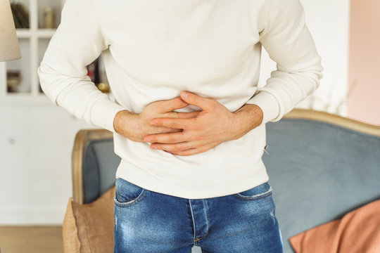 Young man suffering from an abdominal pain