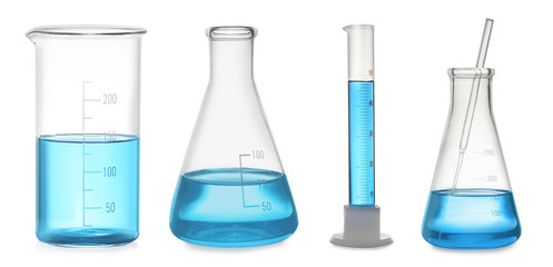 Fototapete - Set of laboratory glassware with blue liquid on white background. Banner design