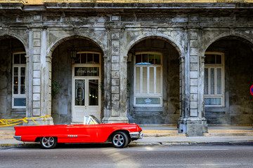 Poster Havana Havana Cuba Red vintage classic american car in a typical colorful street with sunny blue sky