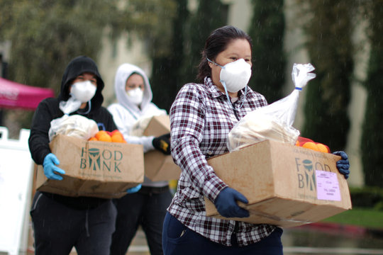 People pick up fresh food at a Los Angeles Regional Food Bank giveaway of 2,000 boxes of groceries, as the spread of the coronavirus disease (COVID-19) continues, in Los Angeles
