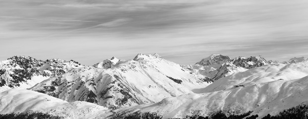 Fototapete - Panorama of snowy slope in high winter mountains and sunlit cloudy sky