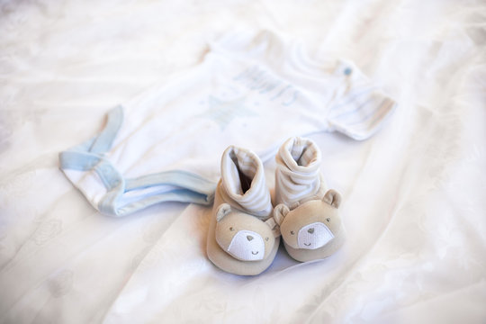 Newborn baby boy set - blue clothes as bodysuit and booties.