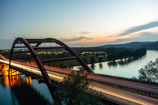 The through arch designed Pennybacker Bridge in Austin, Texas was opened in 1982 and spans more than 1,000 feet. The bridge crosses Lake Austin and the Colorado River.