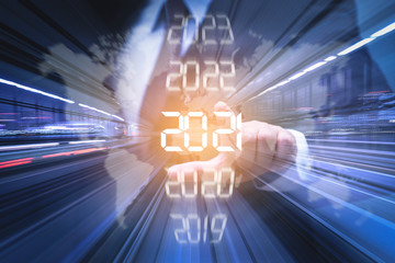New year combined futuristic concept, Businessman pointing at year 2021
