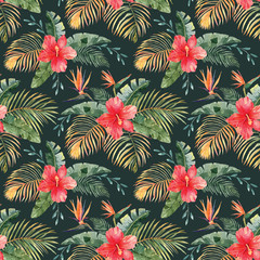 Seamless pattern with hand drawn watercolor tropical flowers and plants. Red hibiscus, bird in paradise flowers and gold and green palm leaves. Surface design for fabric, wrapping paper. Hawaii mood
