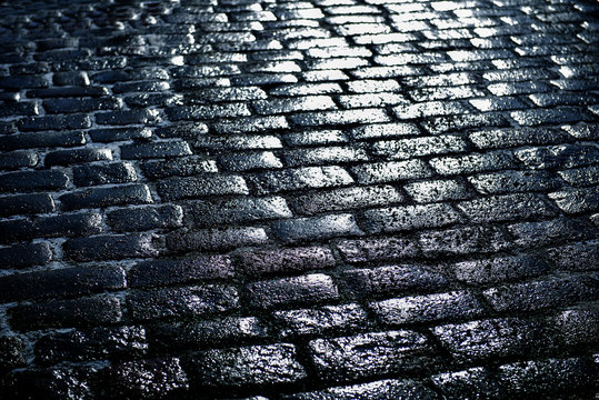 Full Frame Shot Of Wet Cobblestone Footpath