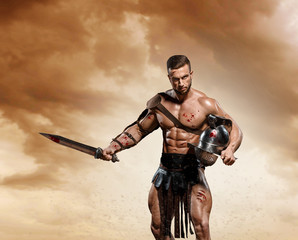 Gladiator fighting on the arena of the Colosseum on dramatic light. Roman Hoplomachus armed fighter Concept historical photo