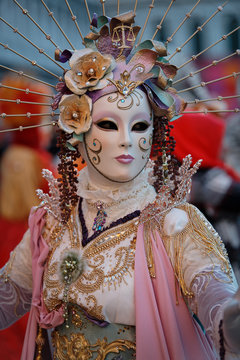 VENICE, ITALY - FEBRUARY 18 , 2020: Unidentified person with Venetian Carnival mask in Venice