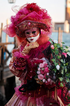 Venice Italy, February 19 2020. Woman in costume and mask photographed for the famous Venitian Carnival.