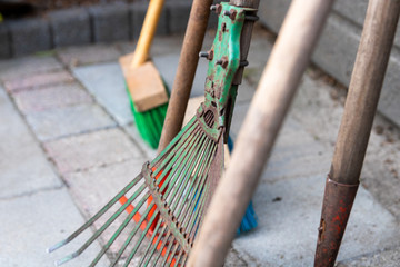 Close up of some Gardening tools. focused on a Rake. tools to clean up a garden.