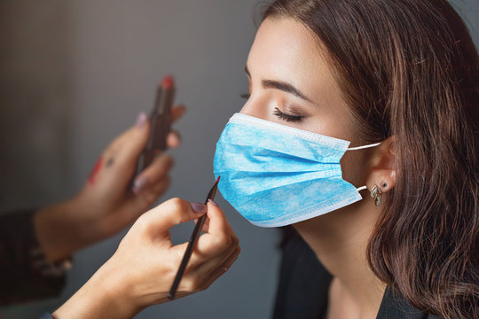 Makeup artist works with a client. Concept on the provision of cosmetic services during the quarantine period due to the covid-19 pandemic