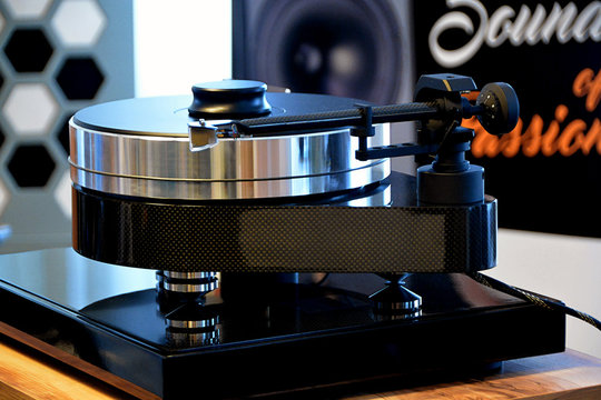 Modern audiophile turntable with vinyl record.