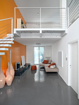 Interiors of a Modern Living Room with Resin Floor and a Staricase