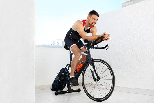 Training on a spinning bike. Sports training on a stationary exercise bike.
