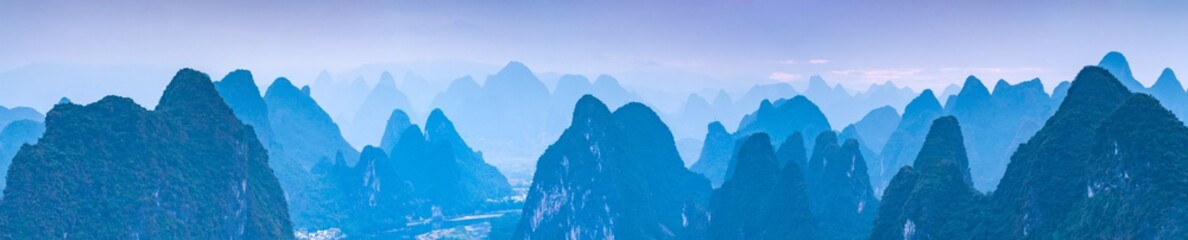 Foto auf Gartenposter Blau Jeans Panoramic view of the Karst mountain landscape near Guilin, Guangxi Province, China