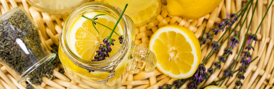 Lemonade with Lemons and Lavender. Cold Infused Detox Water with Lemon and Lavender. Provence Style. Selective focus.