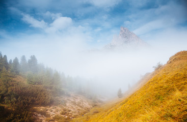 Wall Mural - Misty view of the Mt. Sass de Stria from Falzarego pass. Dolomite alps, Italy, Europe.
