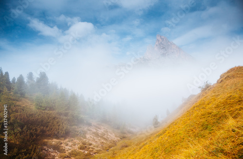 Wall mural Misty view of the Mt. Sass de Stria from Falzarego pass. Dolomite alps, Italy, Europe.