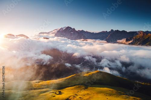 壁紙(ウォールミューラル) Thick fog covered the ridge in morning. Location place Val di Fassa valley, Dolomites, Italy.