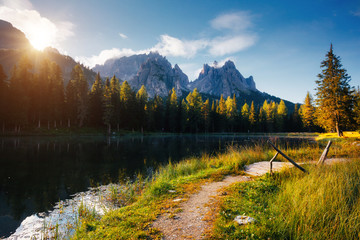 Wall Mural - Great rocks over the lake Antorno, National Park Tre Cime di Lavaredo.