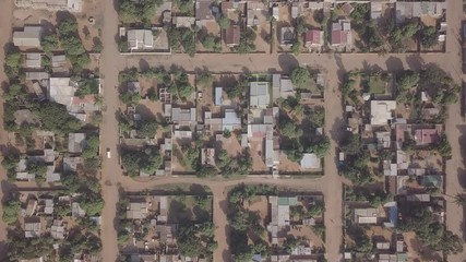 Wall Mural - Aerial patterns made of simple houses in developing suburbs of Maputo, Matola, Mozambique