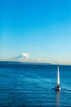 A sailboat on the Puget Sound with Mt Rainer in the distance.