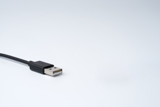 Close-up of black USB Type-A Male cable plug isolated on white background.