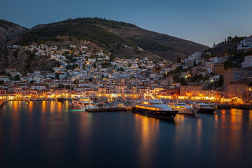HYDRA, GREECE - 9 SEPTEMBER 2018: Panoramic view of Hydra harbor at night.