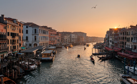 View to grand canal from Rialto bridge at sunset