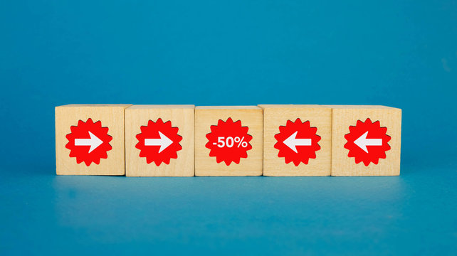 arrows on wooden cubes lead to a 50 percent discount