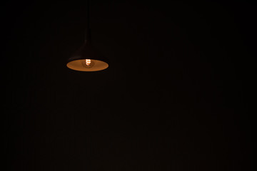 Poster UFO Low Angle View Of Illuminated Light Bulb Against Black Background