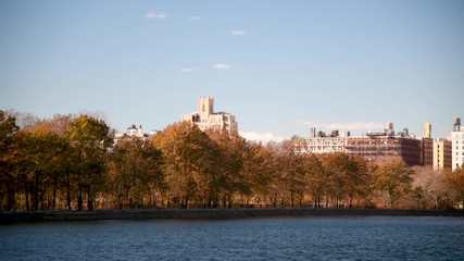 Fototapete - Central Park lake and city buildings on a sunny winter day, Manhattan, New York City, USA