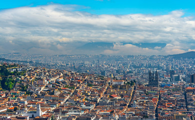Fotomurales - Aerial Panorama of Quito City with the historic city center in the foreground and the modern skyscrapers in the background, Ecuador.