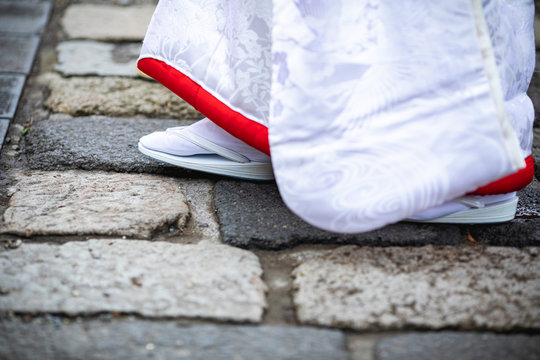Bride walking on the stone wall