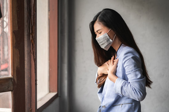 COVID-19 Pandemic Coronavirus, Asian woman have a cold and symptoms coughing, fever, headache and pains