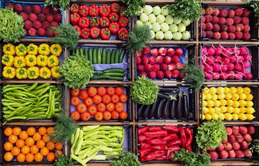 High Angle View Of Various Vegetables And Fruits For Sale At Market Stall