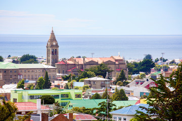 Punta Arenas, Chile, Cityscape.  View of the city and the Strait of Magellan from above. On the left you can see the tower with a spire. this is the largest Church in the city - the Sanctuary of Maria Wall mural