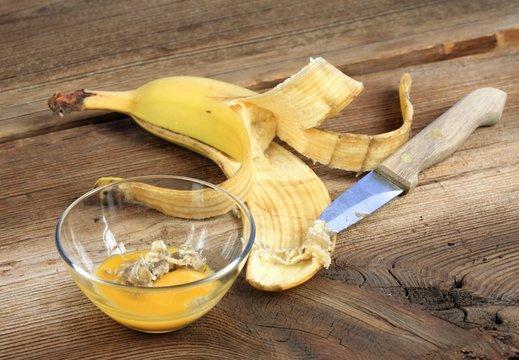 Nourishing banana peel face mask. Homemade face mask made from egg yolk and inside part of banana peel against wrinkles and acne.