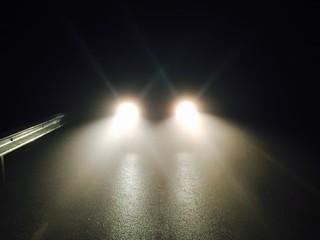 Fotomurales - Illuminated Headlights On Street At Night