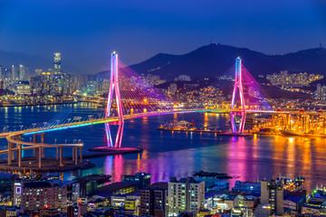 Busan harbor bridge lits up at night in different colors. Taken in Busan, South Korea Fototapete