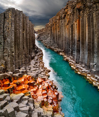 Foto auf Acrylglas Schokobraun Breathtaking view of Studlagil basalt canyon, Iceland, Europe.