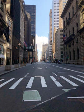 Manhattan, New York, USA. 2020. Looking south on 5th Avenue at 55th Street - Usually very busy shopping area in Midtown.  Seen during the Coronavirus lockdown period.