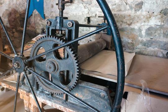 Old printing mechanism. Ancient printing house