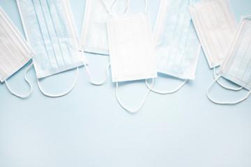Medical masks on a light blue background.