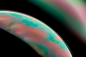 Psychedelic abstract planet from soap bubble, Light refraction on a soap bubble, Macro Close Up in...