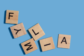 letters FAMILY. Wood alphabet or letters boxes state word. Family conflict and difficulties.